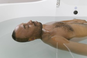 Man relaxing in a float tank