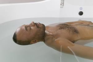 Man relaxing in a float tank